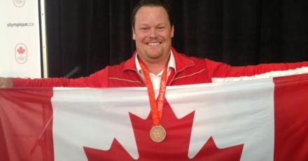 Dylan Armstrong with Olympic Medal